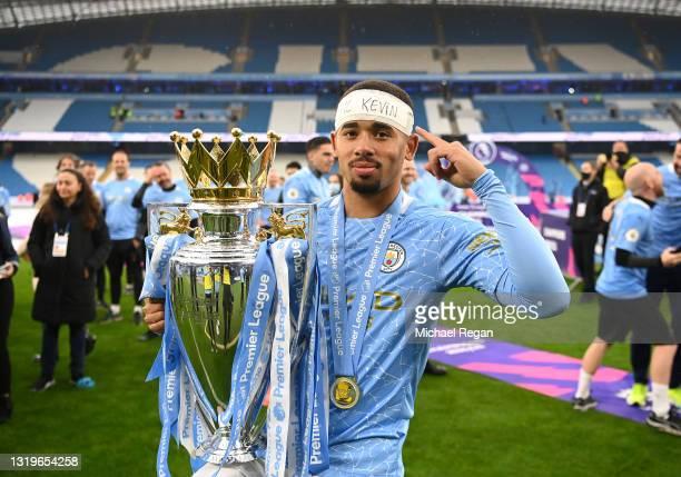 Gabriel Jesus of Manchester City celebrates with the Premier League Trophy as Manchester City are presented with the Trophy as they win the league...