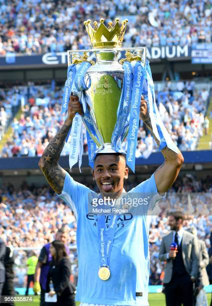 Gabriel Jesus of Manchester City celebrates with The Premier League Trophy after the Premier League match between Manchester City and Huddersfield...