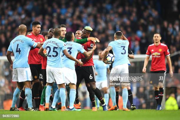 Gabriel Jesus of Manchester City clashes with Paul Pogba of Manchester United during the Premier League match between Manchester City and Manchester...