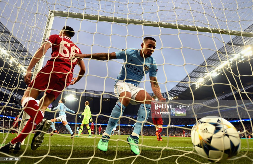 Gabriel Jesus of Manchester City collects the ball out of the net after he scores his sides first goal as Trent Alexander-Arnold of Liverpool reacts during the UEFA Champions League Quarter Final Second Leg match between Manchester City and Liverpool at Etihad Stadium on April 10, 2018 in Manchester, England.