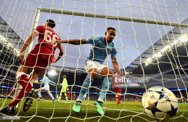 Gabriel Jesus of Manchester City collects the ball out of the net after he scores his sides first goal as Trent AlexanderArnold of Liverpool reacts...