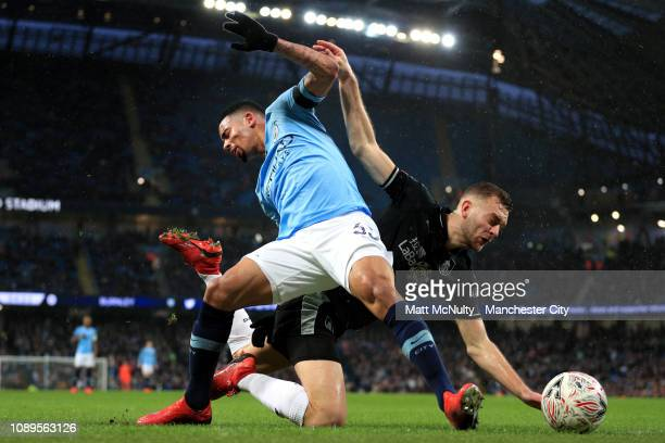 Gabriel Jesus of Manchester City collides with Ben Gibson of Burnley during the FA Cup Fourth Round match between Manchester City and Burnley at...