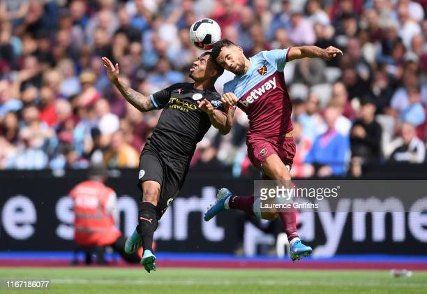 Gabriel Jesus of Manchester City competes for a header with Ryan Fredericks of West Ham United during the Premier League match between West Ham...