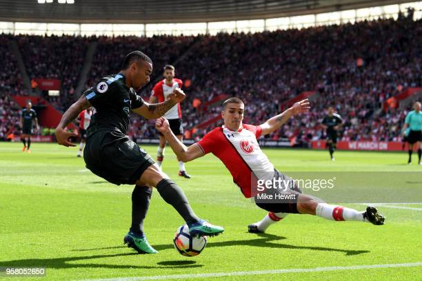 Gabriel Jesus of Manchester City controls the ball as Oriol Romeu of Southampton tries to block during the Premier League match between Southampton...