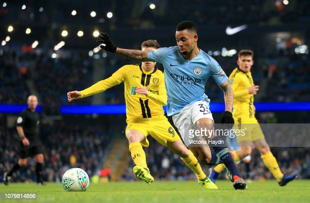 Gabriel Jesus of Manchester City evades Joe Sbarra of Burton Albion during the Carabao Cup Semi Final First Leg match between Manchester City and...