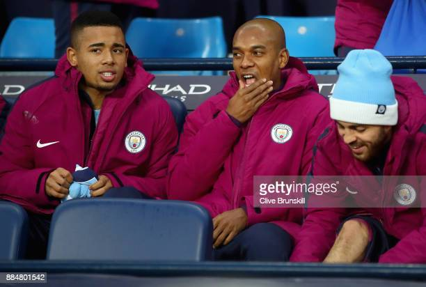 Gabriel Jesus of Manchester City Fernandinho of Manchester City and Bernardo Silva of Manchester City on the bench during the Premier League match...
