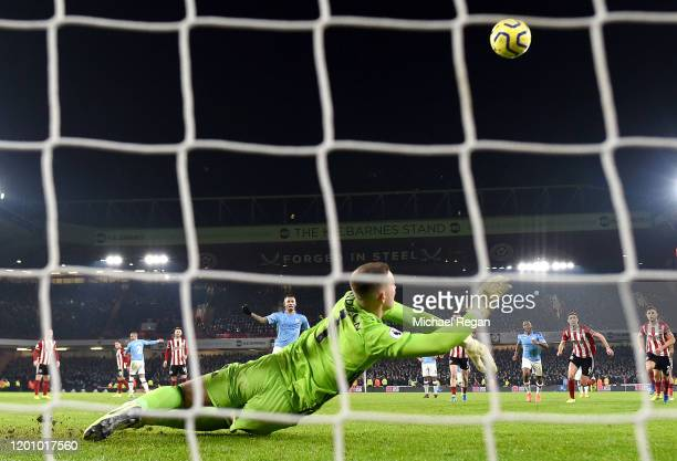 Gabriel Jesus of Manchester City has a penalty saved by Dean Henderson of Sheffield United during the Premier League match between Sheffield United...