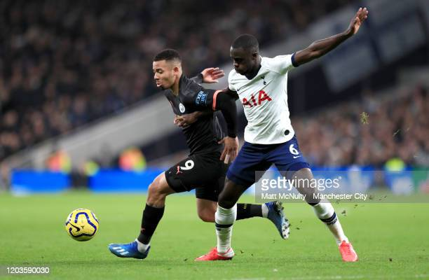 Gabriel Jesus of Manchester City is challenged by Davinson Sanchez of Tottenham Hotspur during the Premier League match between Tottenham Hotspur and...