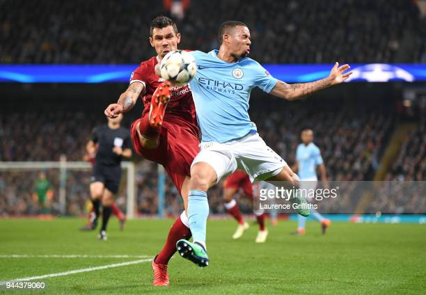 Gabriel Jesus of Manchester City is challenged by Dejan Lovren of Liverpool during the UEFA Champions League Quarter Final Second Leg match between...