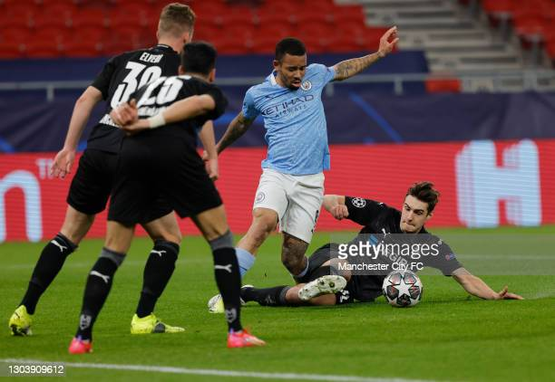 Gabriel Jesus of Manchester City is challenged by Florian Neuhaus of Borussia Moenchengladbach during the UEFA Champions League Round of 16 match...