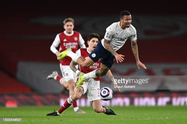 Gabriel Jesus of Manchester City is challenged by Hector Bellerin of Arsenal during the Premier League match between Arsenal and Manchester City at...