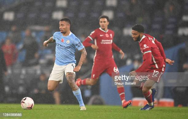 Gabriel Jesus of Manchester City is challenged by Joe Gomez of Liverpool during the Premier League match between Manchester City and Liverpool at...