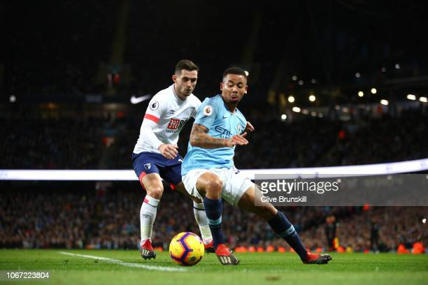 Gabriel Jesus of Manchester City is challenged by Lewis Cook of AFC Bournemouth during the Premier League match between Manchester City and AFC...