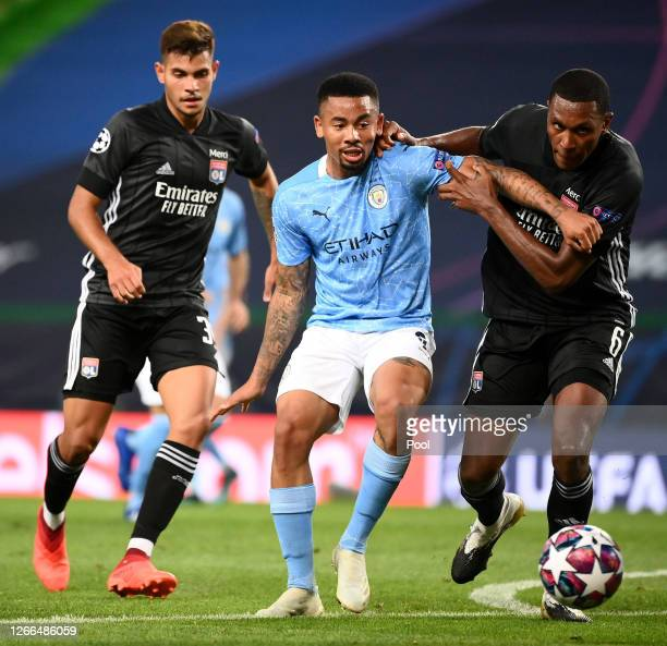 Gabriel Jesus of Manchester City is challenged by Marcelo of Olympique Lyon during the UEFA Champions League Quarter Final match between Manchester...