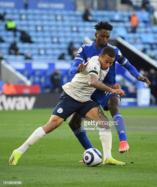 Gabriel Jesus of Manchester City is challenged by Wilfred Ndidi of Leicester City during the Premier League match between Leicester City and...