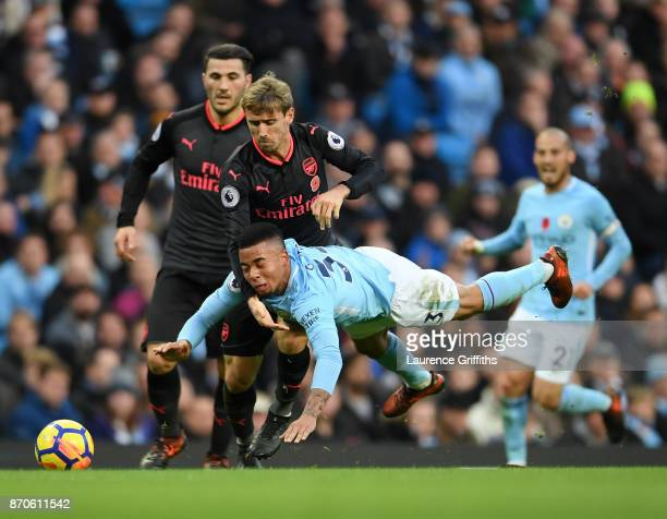 Gabriel Jesus of Manchester City is fouled by Nacho Monreal of Arsenal during the Premier League match between Manchester City and Arsenal at Etihad...