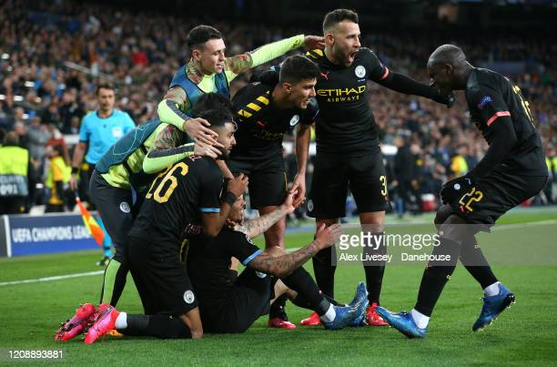 Gabriel Jesus of Manchester City is mobbed by team mates after scoring their first goal during the UEFA Champions League round of 16 first leg match...