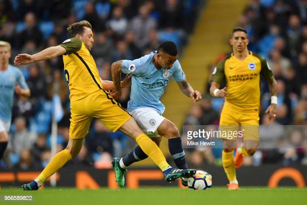 Gabriel Jesus of Manchester City is tackeld by Dale Stephens of Brighton and Hove Albion during the Premier League match between Manchester City and...