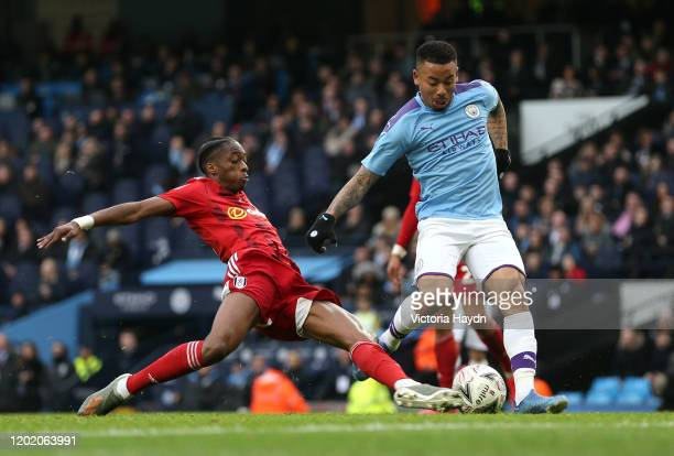 Gabriel Jesus of Manchester City is tackled by Terence Kongolo of Fulham during the FA Cup Fourth Round match between Manchester City and Fulham at...
