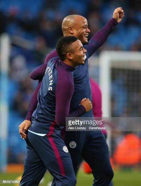 Gabriel Jesus of Manchester City jokes with Vincent Kompany during the warm up prior to the Premier League match between Manchester City and West Ham...