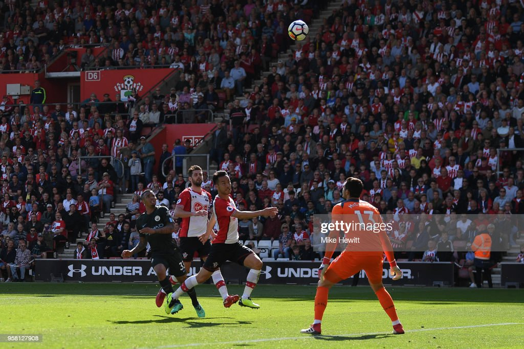 Gabriel Jesus of Manchester City lobs the ball over Alex McCarthy of Southampton to score the winning goal during the Premier League match between Southampton and Manchester City at St Mary's Stadium on May 13, 2018 in Southampton, England.