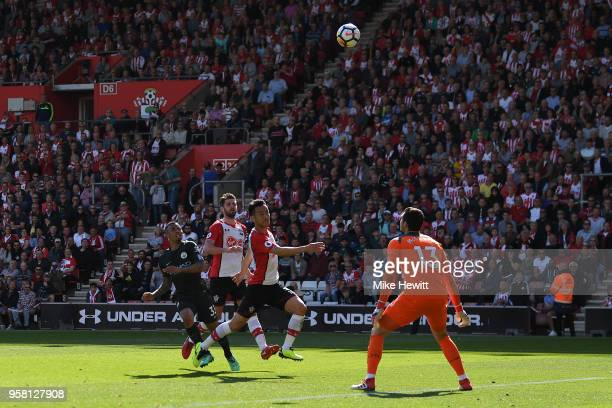 Gabriel Jesus of Manchester City lobs the ball over Alex McCarthy of Southampton to score the winning goal during the Premier League match between...