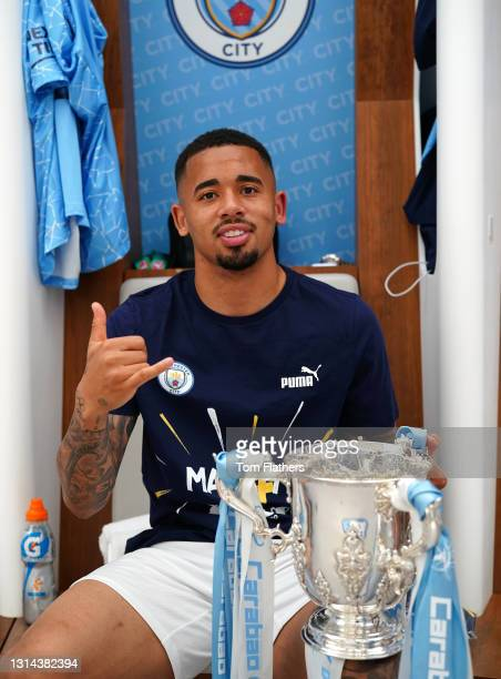 Gabriel Jesus of Manchester City poses for a photograph with the Carabao Cup Trophy inside the dressing room after the Carabao Cup Final between...