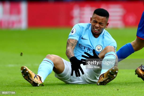 Gabriel Jesus of Manchester City reacts after injuring himself during the Premier League match between Crystal Palace and Manchester City at Selhurst...