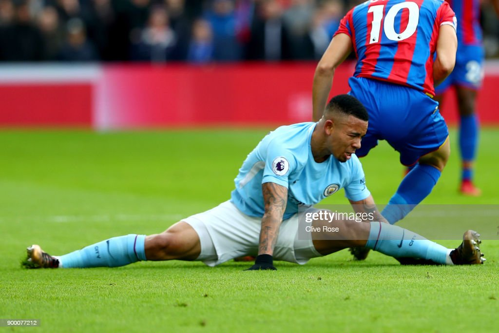 Gabriel Jesus of Manchester City reacts after injuring himself during the Premier League match between Crystal Palace and Manchester City at Selhurst Park on December 31, 2017 in London, England.