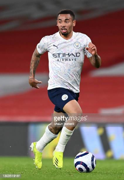 Gabriel Jesus of Manchester City runs with the ball during the Premier League match between Arsenal and Manchester City at Emirates Stadium on...