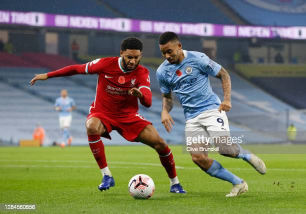 Gabriel Jesus of Manchester City runs with the ball past Joe Gomez of Liverpool during the Premier League match between Manchester City and Liverpool...