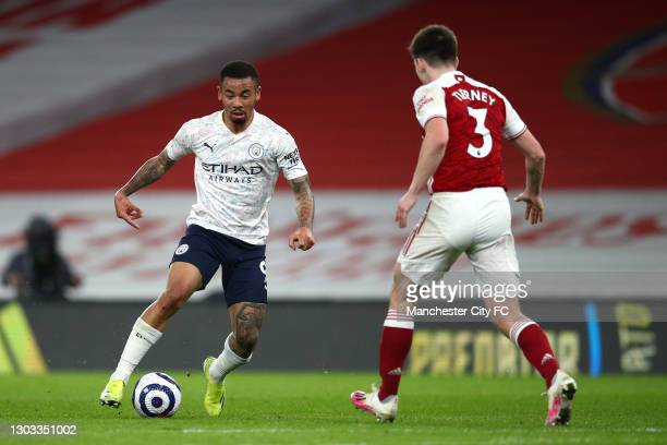 Gabriel Jesus of Manchester City runs with the ball whilst under pressure from Kieran Tierney of Arsenal during the Premier League match between...