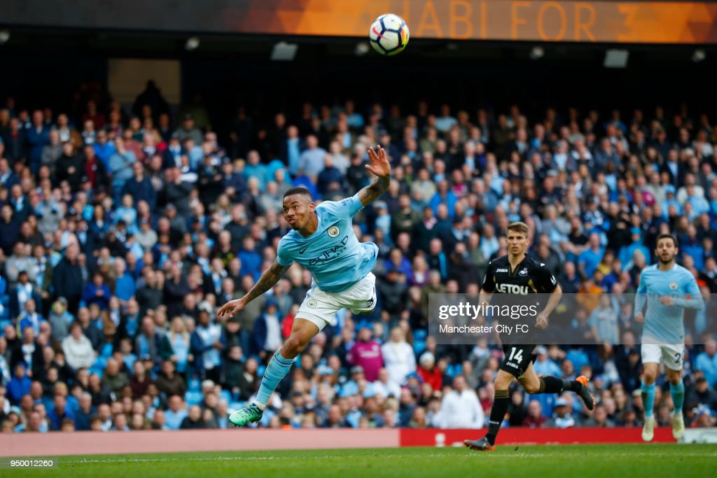 Gabriel Jesus of Manchester City scores his side's fifth goal during the Premier League match between Manchester City and Swansea City at Etihad Stadium on April 22, 2018 in Manchester, England.