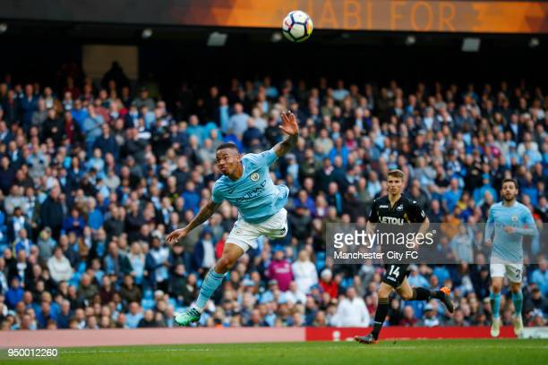 Gabriel Jesus of Manchester City scores his side's fifth goal during the Premier League match between Manchester City and Swansea City at Etihad...