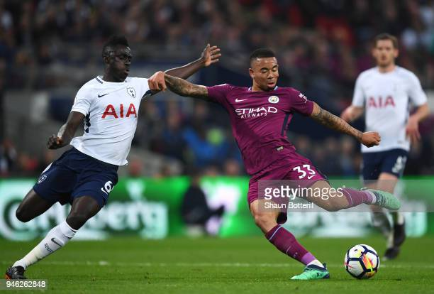 Gabriel Jesus of Manchester City scores his sides first goal while under pressure from Davinson Sanchez of Tottenham Hotspur during the Premier...