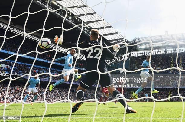 Gabriel Jesus of Manchester City scores his sides second goal past Simon Mignolet of Liverpool during the Premier League match between Manchester...