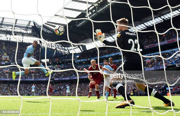 Gabriel Jesus of Manchester City scores his sides second goal past Simon Mignolet of Liverpool during the Premier League match between Manchester...