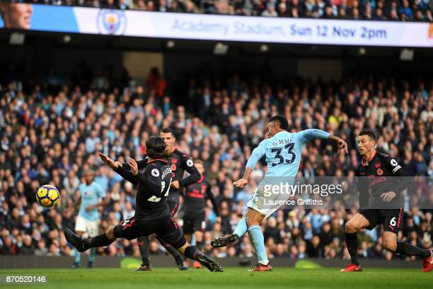 Gabriel Jesus of Manchester City scores his sides third goal during the Premier League match between Manchester City and Arsenal at Etihad Stadium on...