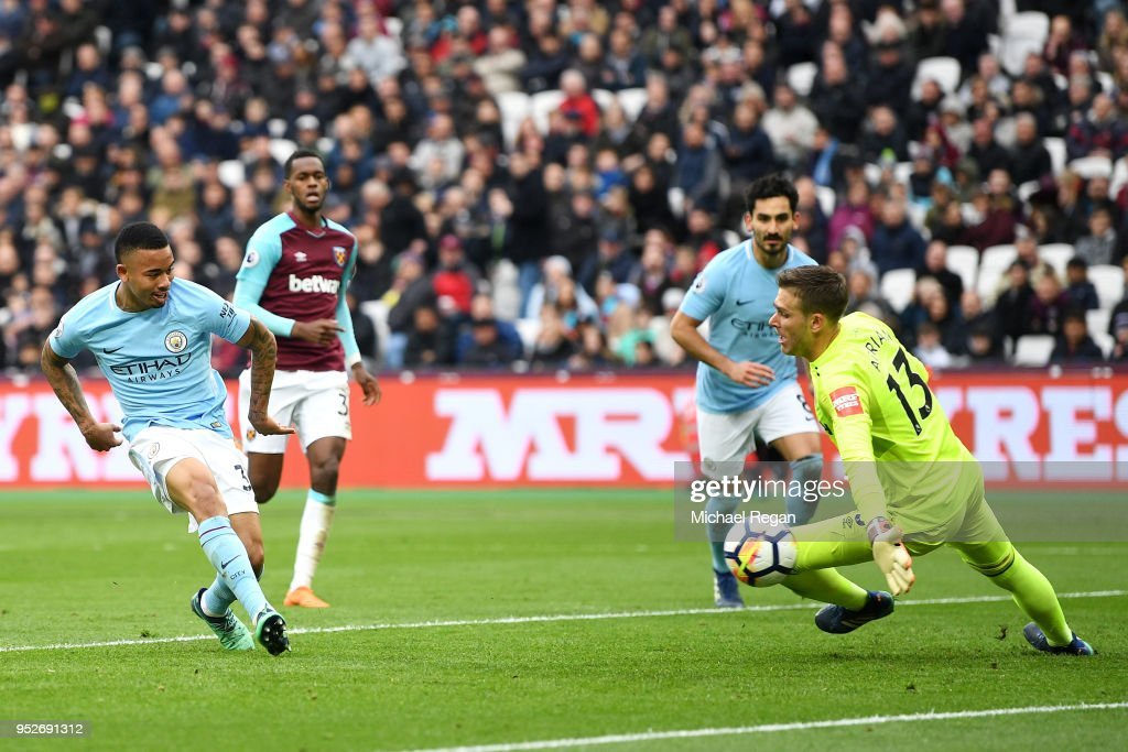 Gabriel Jesus of Manchester City scores his sides third goal past Adrian of West Ham United during the Premier League match between West Ham United and Manchester City at London Stadium on April 29, 2018 in London, England.