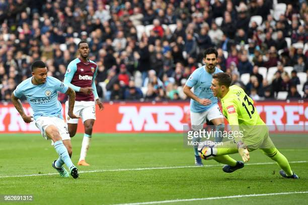 Gabriel Jesus of Manchester City scores his sides third goal past Adrian of West Ham United during the Premier League match between West Ham United...