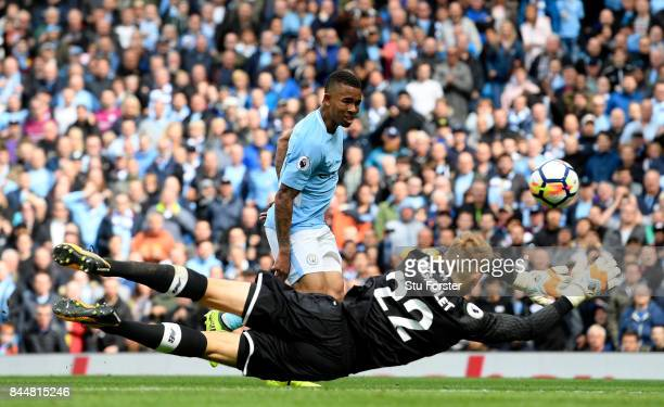 Gabriel Jesus of Manchester City scores his sides third goal past Simon Mignolet of Liverpool during the Premier League match between Manchester City...
