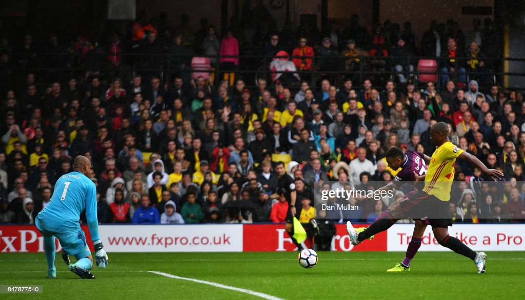 Gabriel Jesus of Manchester City scores his sides third goal past Heurelho Gomes of Watford during the Premier League match between Watford and Manchester City at Vicarage Road on September 16, 2017 in Watford, England.