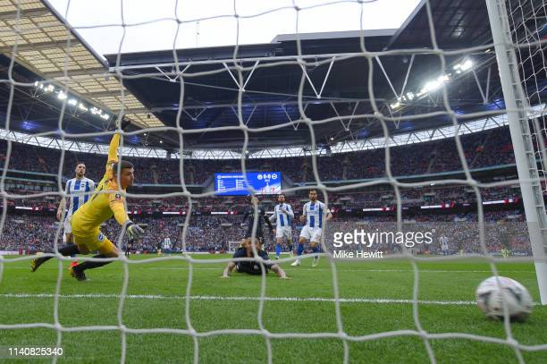 Gabriel Jesus of Manchester City scores his team's first goal past Mathew Ryan of Brighton and Hove Albion during the FA Cup Semi Final match between...
