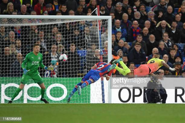 Gabriel Jesus of Manchester City scores his teams first goal past Joel Ward and Wayne Hennessey of Crystal Palace during the Premier League match...