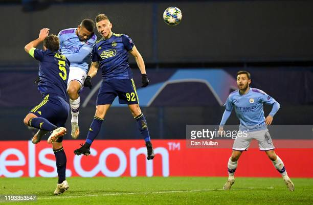 Gabriel Jesus of Manchester City scores his team's first goal past Damian Kadzior and Arijan Ademi of GNK Dinamo Zagreb during the UEFA Champions...