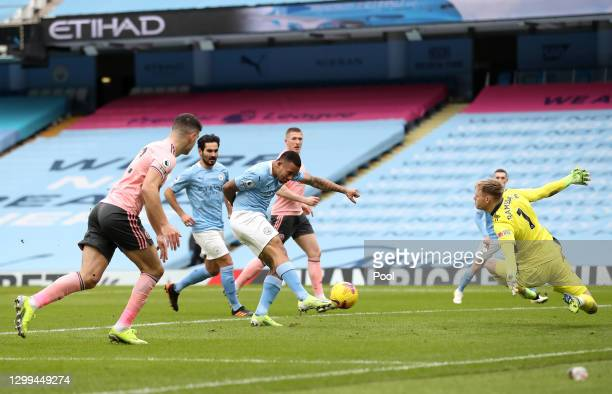 Gabriel Jesus of Manchester City scores his team's first goal past Aaron Ramsdale of Sheffield United during the Premier League match between...