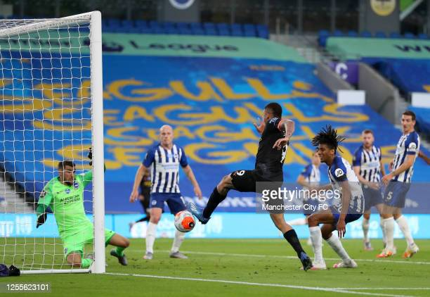 Gabriel Jesus of Manchester City scores his team's second goal during the Premier League match between Brighton & Hove Albion and Manchester City at...