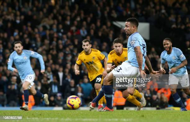 Gabriel Jesus of Manchester City scores his team's second goal from a penalty during the Premier League match between Manchester City and...