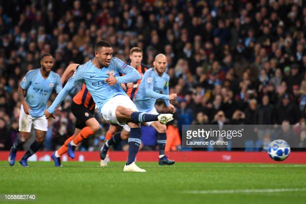 Gabriel Jesus of Manchester City scores his team's second goal from the penalty spot during the Group F match of the UEFA Champions League between...