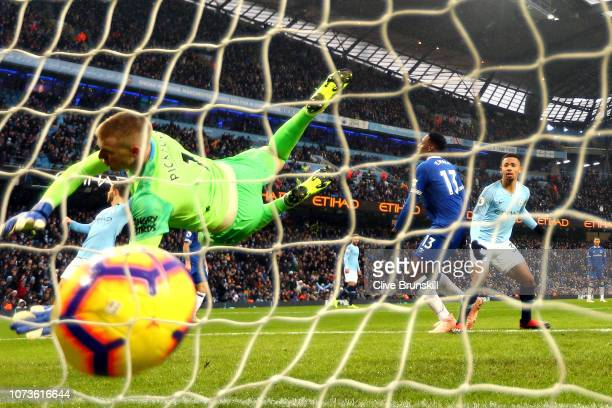 Gabriel Jesus of Manchester City scores his team's second goal past Jordan Pickford of Everton during the Premier League match between Manchester...